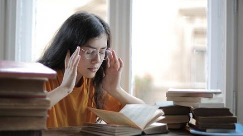 Woman looking stressed while studying